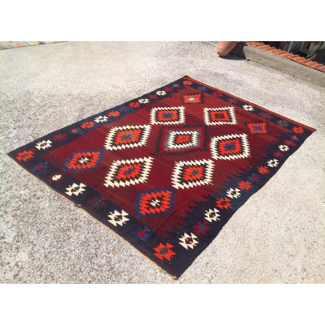 This beautiful, vintage, handwoven kilim is approximately 60 years old. It is handmade of wool in all natural colors. It...