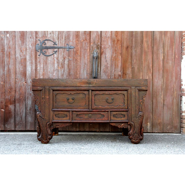 This beautiful lacquered finished console has a scrolled front and slate top, it stands on carved legs, features three...