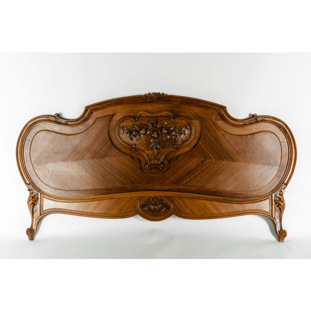 Late 19th century French burl walnut beds. The bed is in excellent antique condition, with headboard, footboard, side...