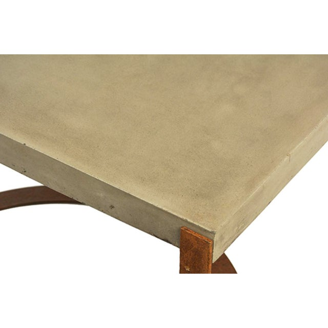 Modern industrial outdoor coffee table with lightweight concrete top and unique design rust finish iron base. Great for...
