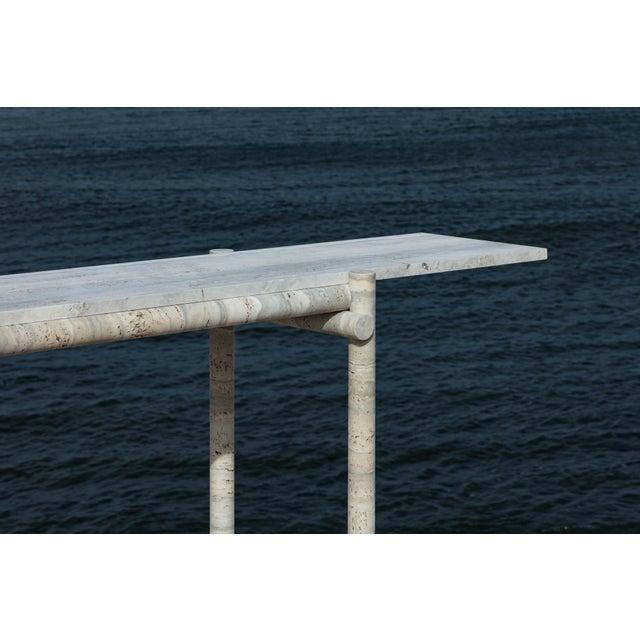 Original ocean travertine console by Clement Brazille Material : Ocean travertine stone Dimensions : 160 x 30 x 75 cm...