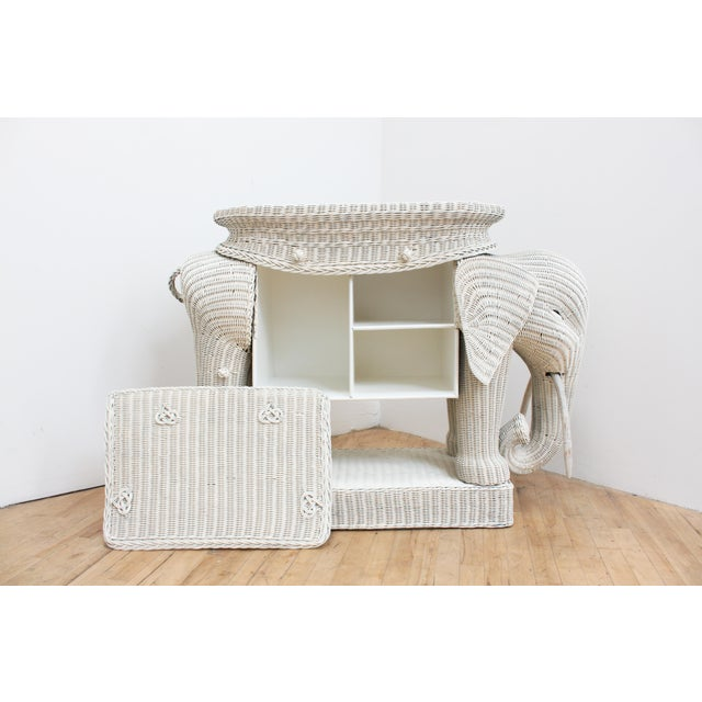 Rare vintage Mario Torres style wicker elephant bar. Includes original removable mirror and rattan base tray top. One side...