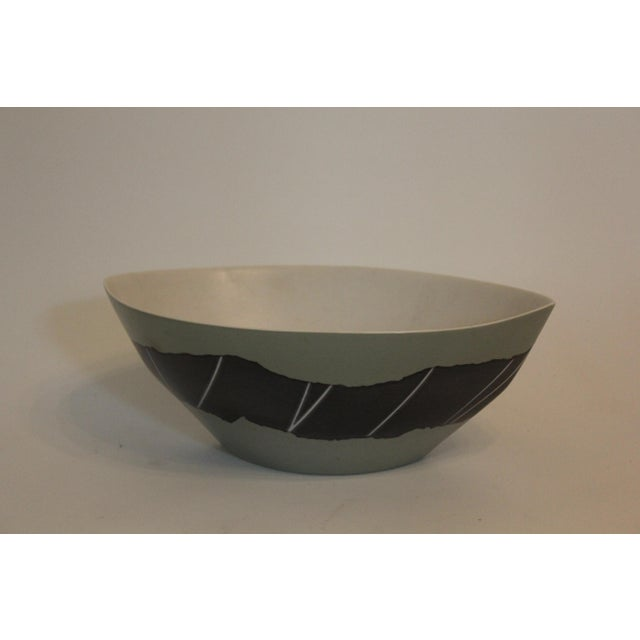 This pointed-oval-shaped bowl of matte glazed ceramic was purchased at the Philadelphia Museum of Art Craft Show. The...