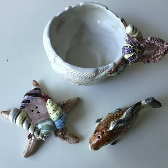 I have a three-piece set from vintage Fitz and Floyd. Sea life beautifully depicted on this adorable set of salt and...