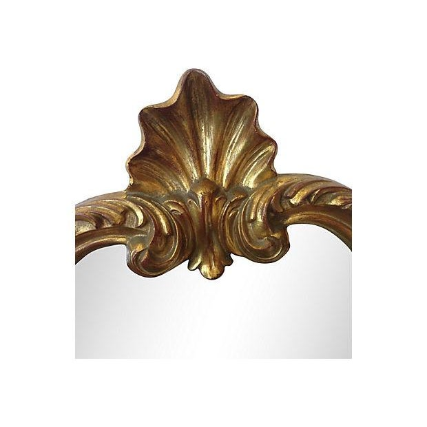 A lovely gilt accent mirror with shell decoration. Made in Belgium.