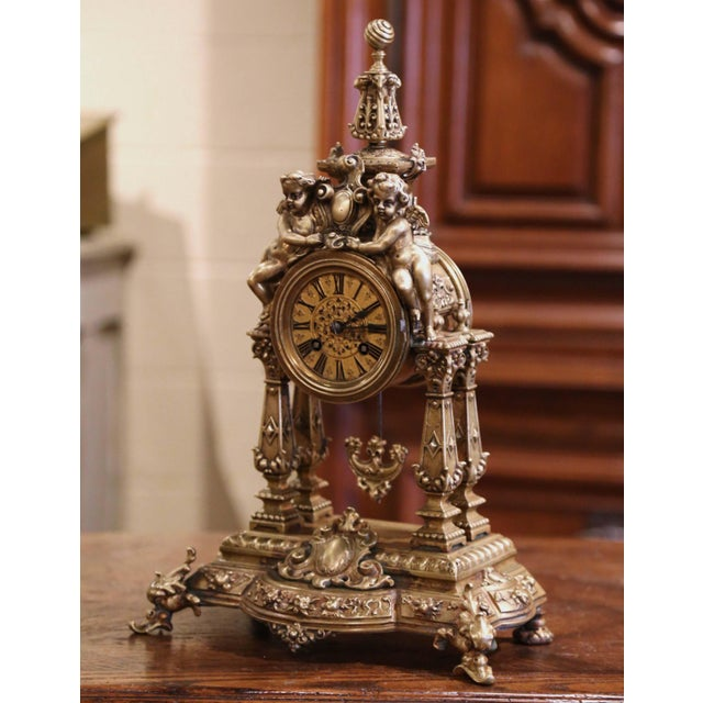 Crafted in Paris, France circa 1860, the antique time keeper stands on an attached ornate base over scrolled feet; the...