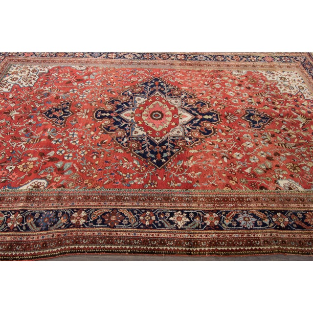 A hand-knotted Antique Farahan Sorouk Rug with a geometric design on a multi-color field.