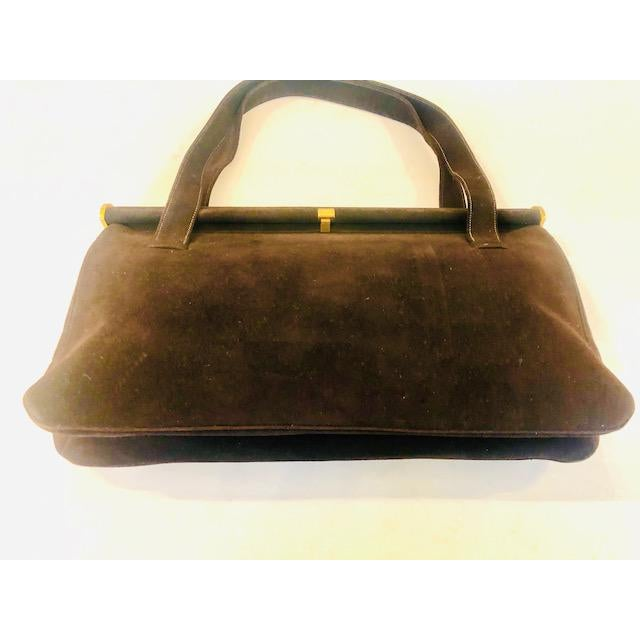 The pictures do not capture the richness of this Koret purse. Softest chocolate calfskin suede with rich matching satin...