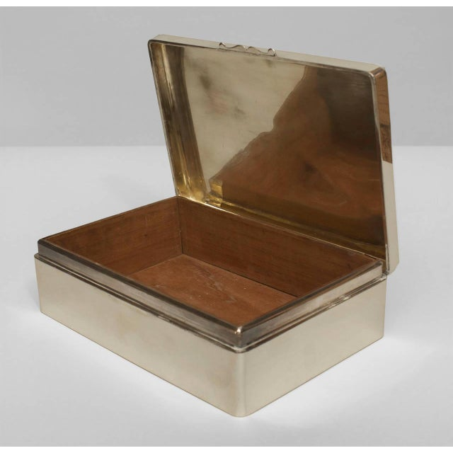 English Art Deco rectangular sterling silver box with a light beige shagreen top decorated with an inlaid intersecting...