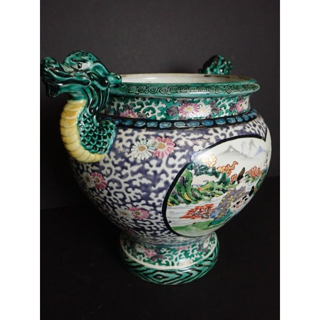 Asian (Japanese / Chinese) art pottery. Hand painted ceramic vase with figural and floral design. No noticeable maker's mark.