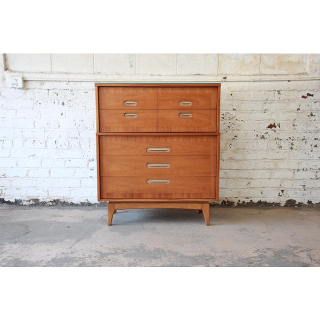 """Offering a very nice Kent Coffey """"Focus"""" highboy dresser. The dresser offers five deep pocketed smooth sliding drawers...."""