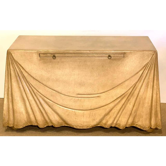 Stunning Aldo Tura Parchment leather Trompe l'oeil Draped console with pullout writing slide. The realistically carved...
