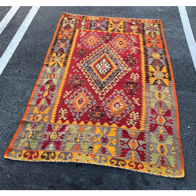 This is a vivid colored vintage Cal Kilim, from Turkey. It is hand-woven out of wool and was made about 90 years ago. It...