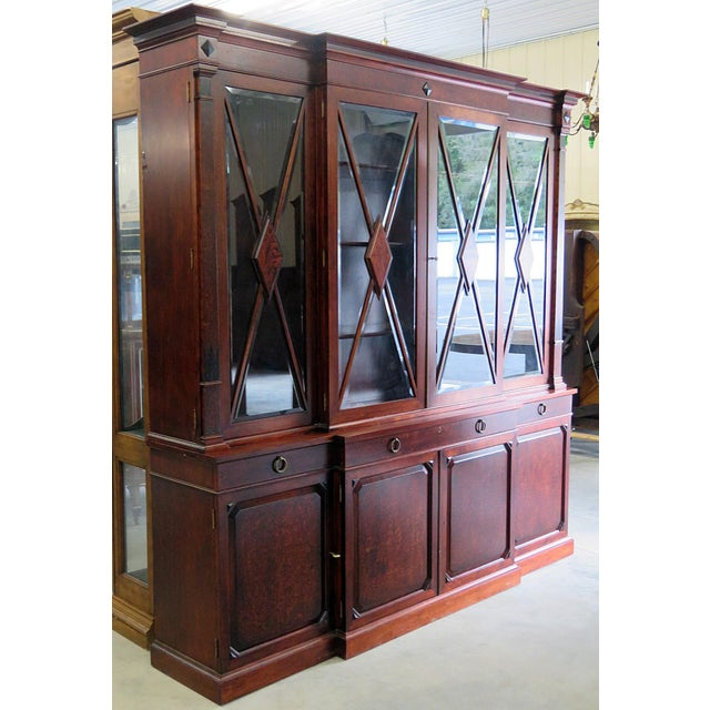 Regency style breakfront with beveled glass.