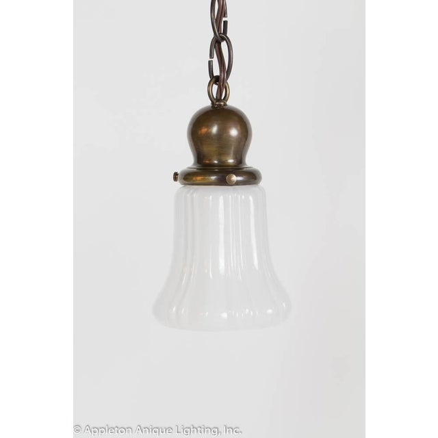 Pair of Sheffield pan lights with new glass. Medium antique patina. Price is per pendant.