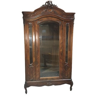 1930s Antique Walnut Armoire With Hand Carvings and Beveled Glass For Sale