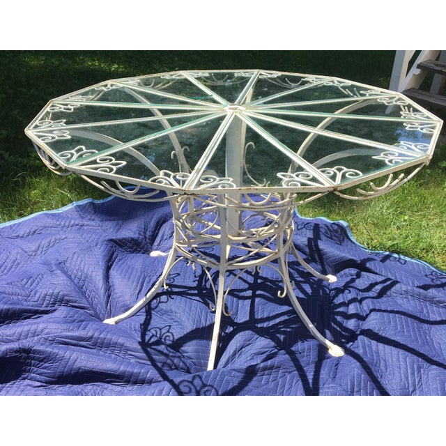 Very fine late 19th Century wrought iron center table featuring a very rare dodecagon 12-sided polygon geometric top. The...