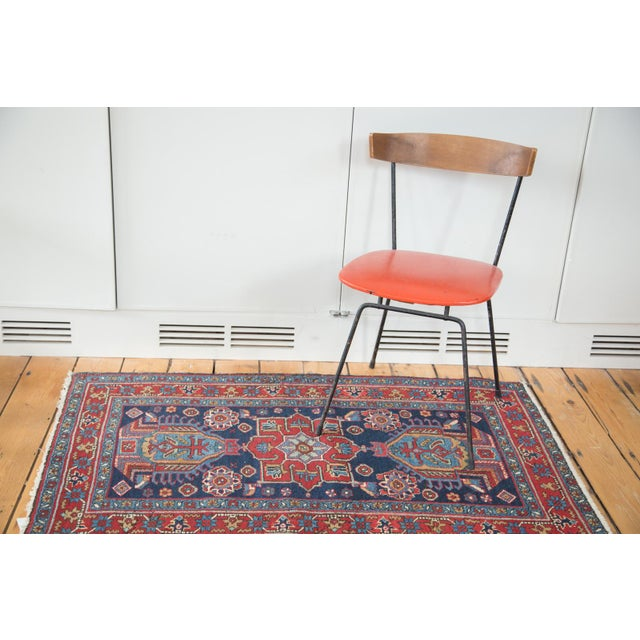 Bold small rug with powerful shades of deep indigo blue and rich cherry wine red. Star border with meandering leaf minor...