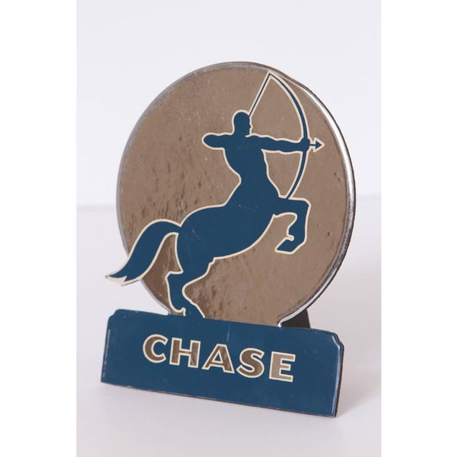 Art Deco 1930s chase brass and copper company advertising stand. Rare iconic chase centaur with long-bow logo. Embossed...