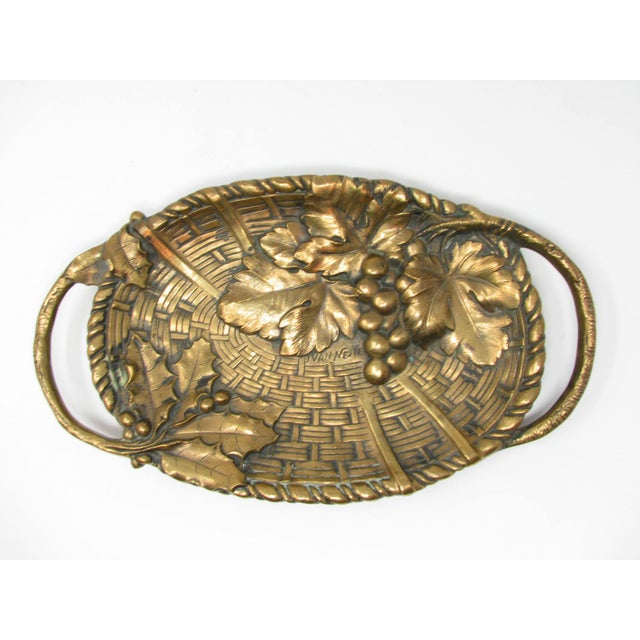 Antique Art Nouveau solid bronze tray, bowl or vid-pocke in the shape of a basket with grapes and grape leaves by artist...