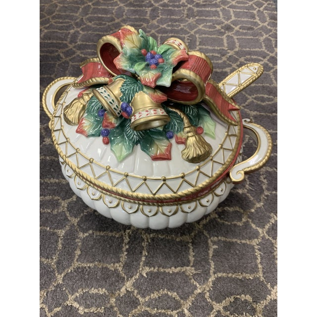Christmas Deer ceramic serveware by Fitz and Floyd including a covered tureen with ladle. The spherical tureen features...
