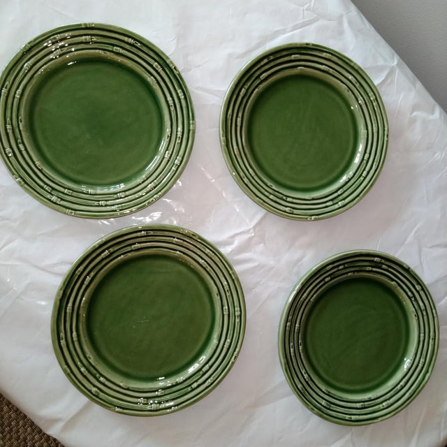 """This is a set of 4 Portuguese green decorative plates with a bamboo relief border, 8"""" in diameter. Great wall display or..."""