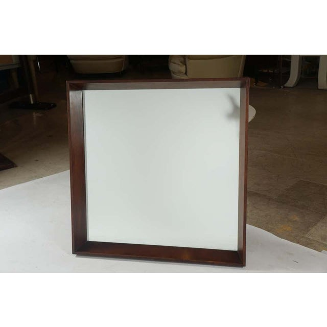 A rare Gilbert Rohde classic mirror in walnut by Herman Miller from the 1940s in very nice original condition.