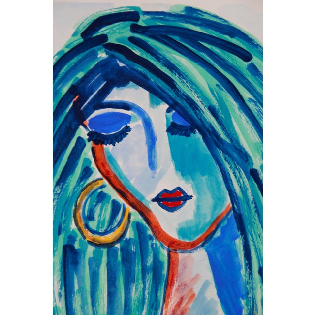 Abstract female face or portrait in blues: indigo, aqua,cobalt, with a hint of red, orange and yellow. Gouache on...