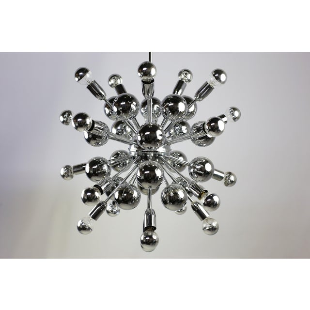 This is the real thing! This beautiful original True Mid Century Modern Sputnik chandelier by Lightolier is in amazing...