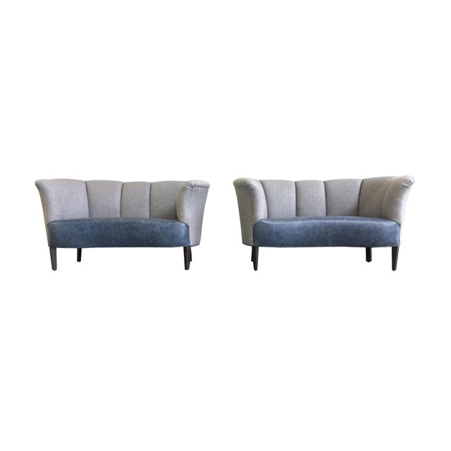 These Mid-20th Century Danish settees were originally designed by Slagelse Møbelvaerk. They are newly and completely...