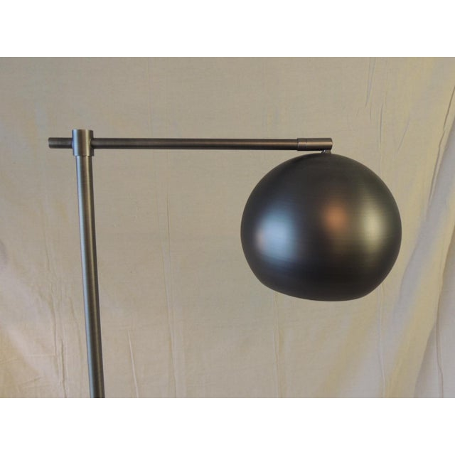 "Gun Metal Finish Articulated Floor Lamp Floor on/off button. Size: 61.5""H x 10"" base x 17""D x 7""D head."