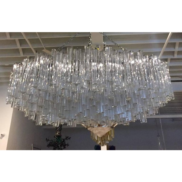 Monumental Mid-Century Modern Italian chandelier by Venini. Each of the prisms are solid glass, measuring 10 inches each....