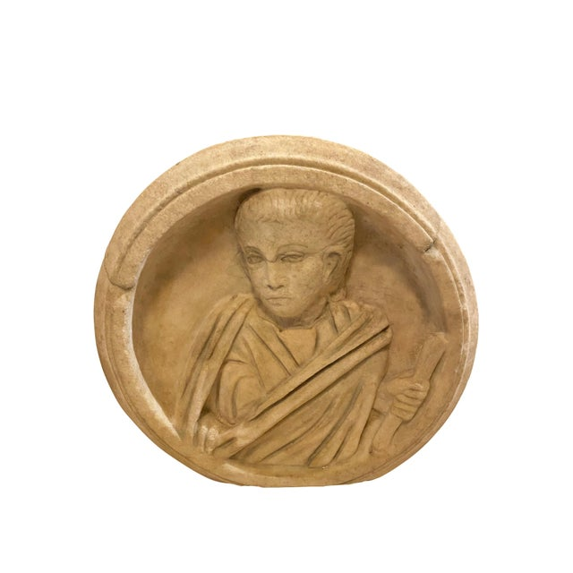 Depicting a robed man holding a scroll in a circular frame. Purchased in Southern California.