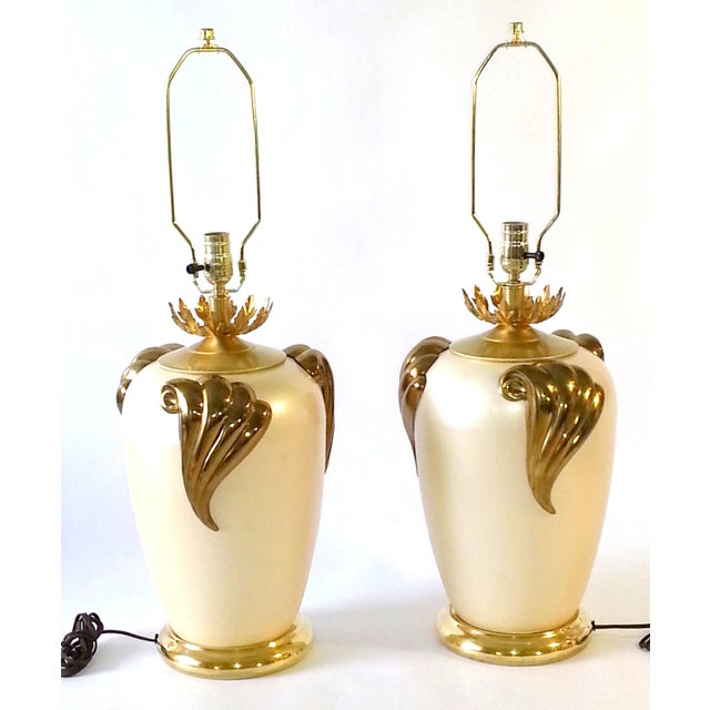 This item consists of a pair of Mid-Century table lamps, hand painted cast metal each with three (3) brass ornaments...