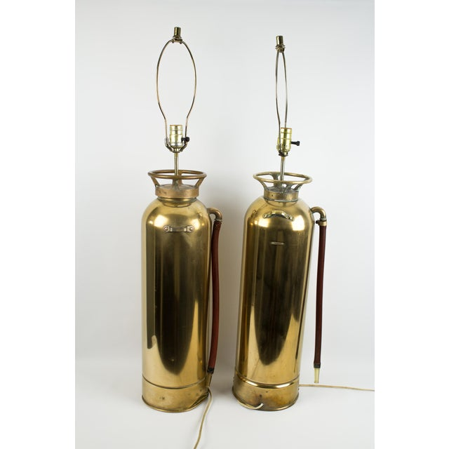 Gorgeous pair of antique brass fire extinguishers refurbished into lamps. Brass extinguishers with a rubber / vinyl hose...