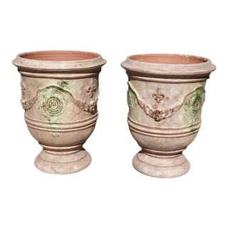 Modern French Mid Sized Distressed Terra Cotta Planters- A Pair For Sale