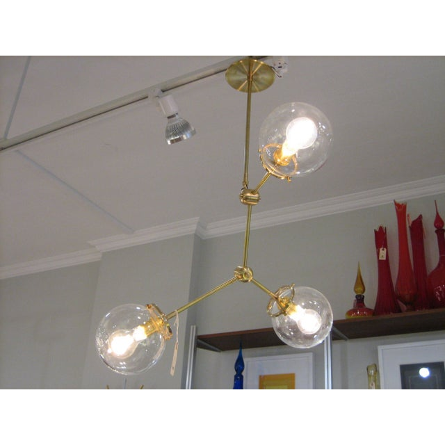 This custom three globe chandelier is a hip contemporary alternative to a dining room or foyer chandelier. Available in...