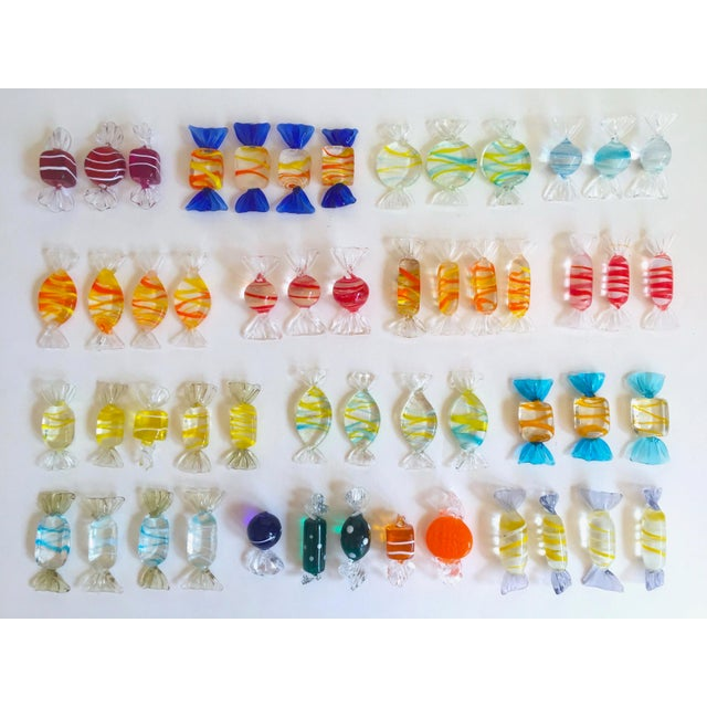 This fifty two piece set of vintage Mid Century Modern Italian hand blown Murano art glass candies is a very special and...
