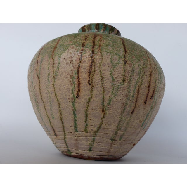 Offered to you is this beautiful vintage glaze terracotta vase , great earthy colors and lots of texture and details even...