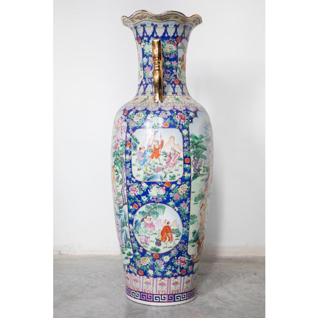 20th century, Large Floor Vase of Chinese Canton Famille Rose illustrated with beautiful Chinese characters and features...