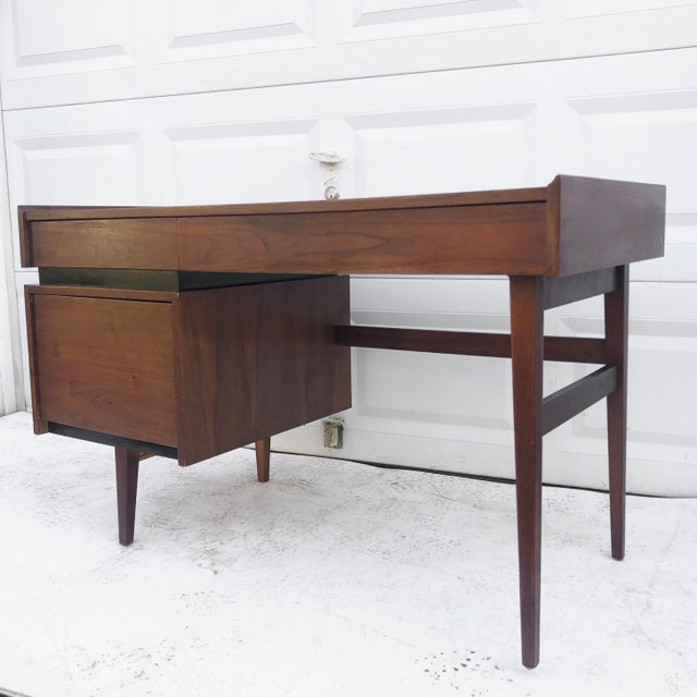This stylish mid-century writing desk by Dillingham furniture features unique mid-century style, spacious drawers for...