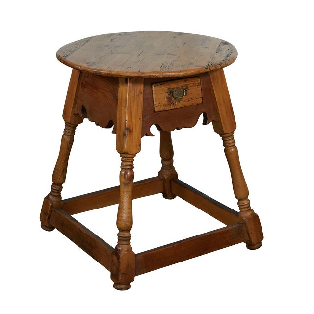 This round side table has great details including a shaped skirt, turned legs and hand carved stretchers. The table has...
