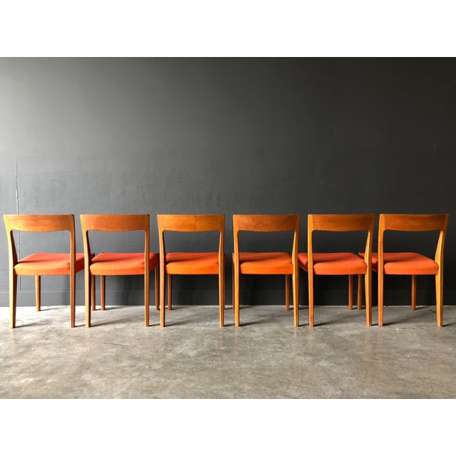 Set of 6 teak dining chairs made by Svegards Markaryd. Original orange wool fabric, in excellent condition. This set has a...
