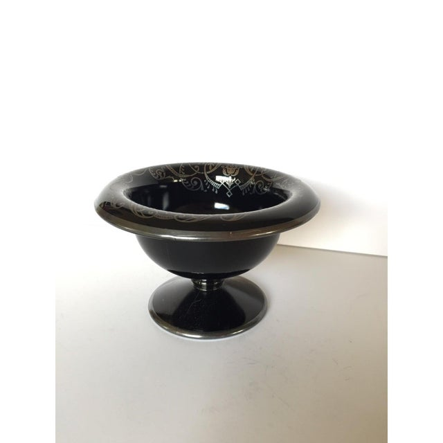 This pedestal bowl is a favorite piece from my collection! Opaque glossy black glass is made in the perfect shape! The...