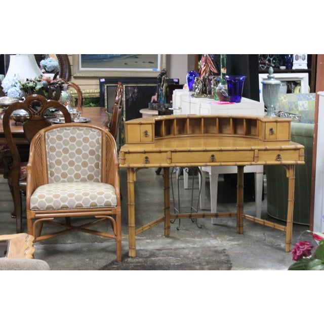 I believe this is a Ficks Reed Demilune Writing Desk but although in excellent condition there is no tag on it. Chair is...