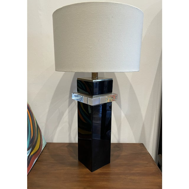 Elegant shiny black finish in combination with clear hard plastic section cut makes this understated lamp worth the extra...