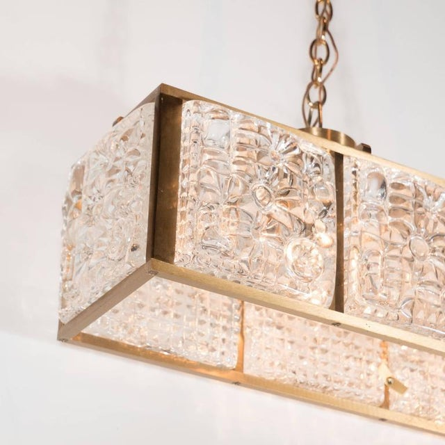 Exceptional mid century rectangular pendant chandelier in brass with a mid century modernist rectangular pendant chandelier in polished brass with textured glass panels aloadofball Gallery