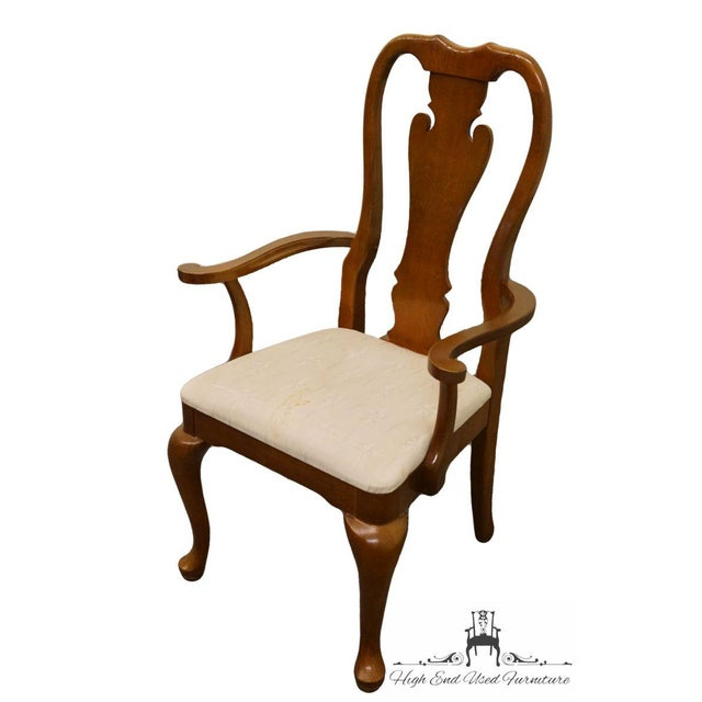 Thomasville Furniture Winston Court Collection Queen Anne dining arm chair featuring an upholstered seat. Model 20621-831-832