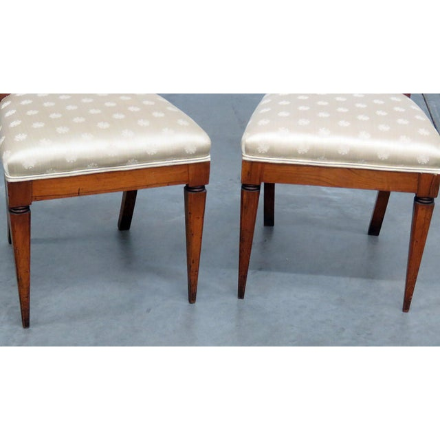 Pair of antique Austrian side chairs with gilt accents. Perfect for a traditional home.