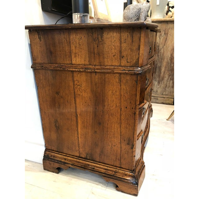 Beautiful 17th century Italian four drawer walnut commode with shaped drawer fronts, original hardware and carved bracket...